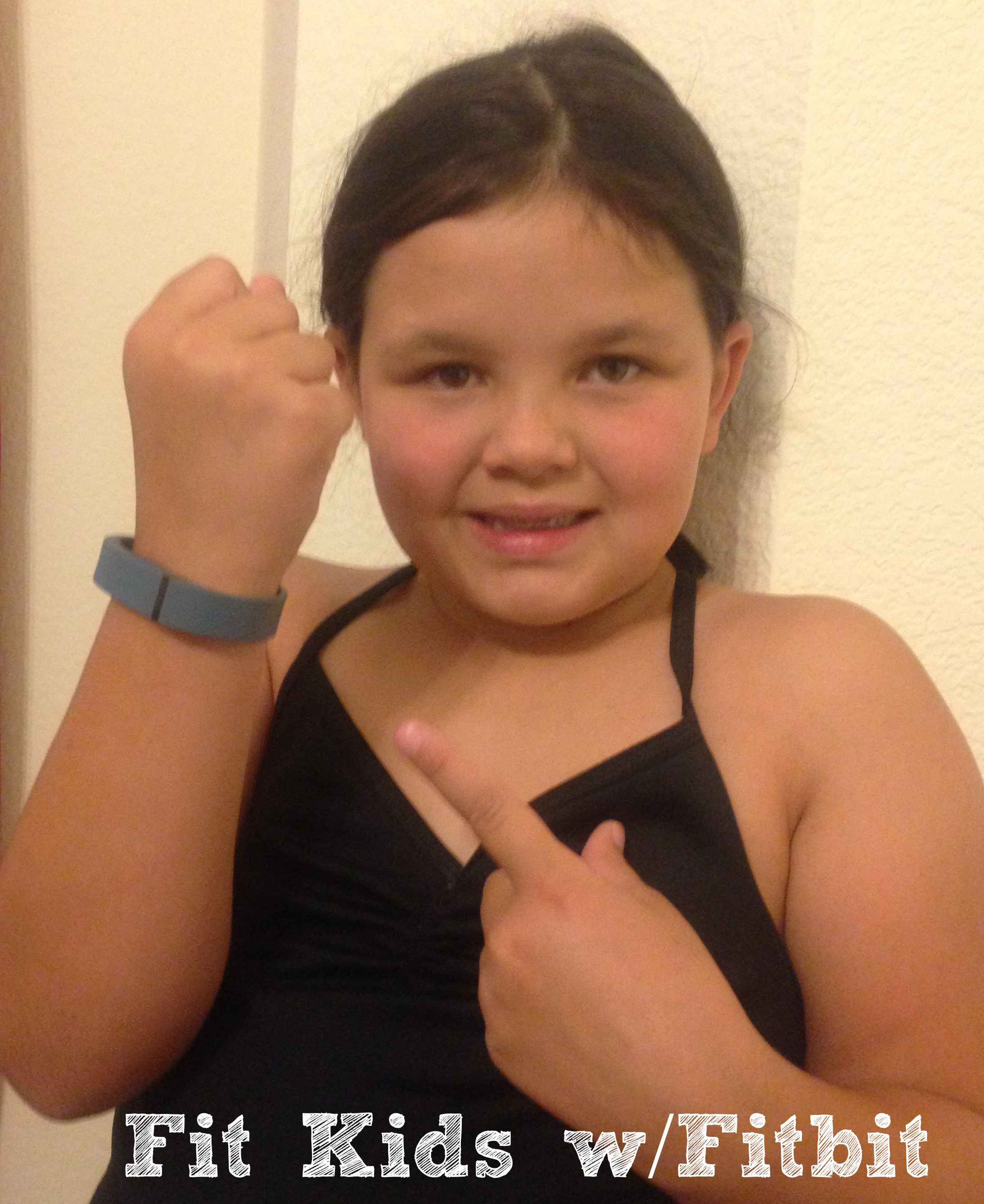 for kids fitbit how to turn it on